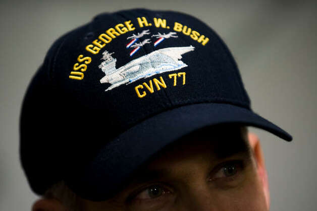 An officers hat shows the USS  George H.W. Bush and the ship's designation of CVN77. Photo: Smiley N. Pool, Houston Chronicle