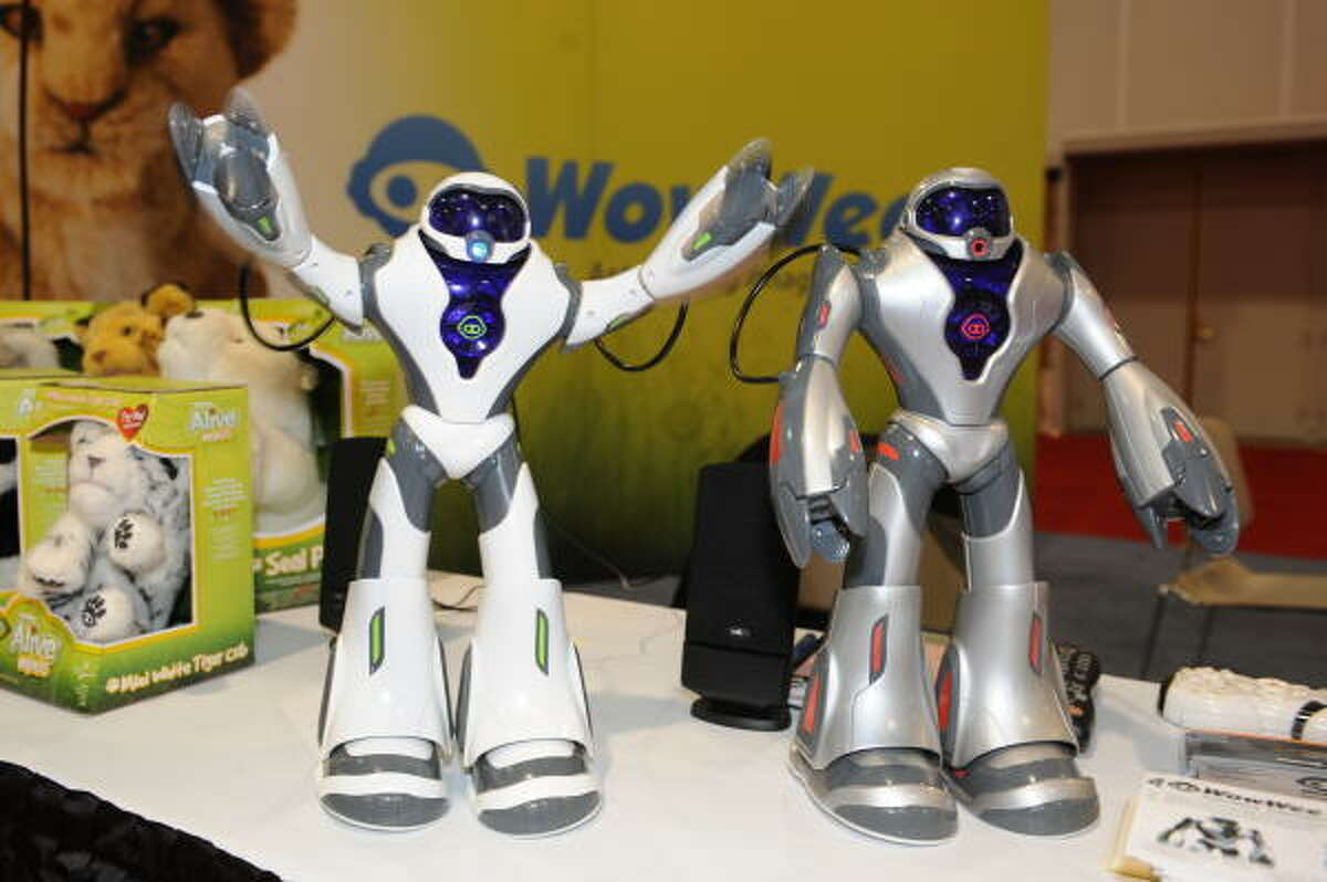 """The Joebot robot by Wow Wee gestures at the 2009 Consumer Electronics Show in Las Vegas Jan. 8. Joebot walks, talks, and beatboxes. The unit's voice command feature enables it to respond to specific phrases. Joebot also has a """"battle mode"""" that makes it walk around and shoot at things with its hand weapons."""