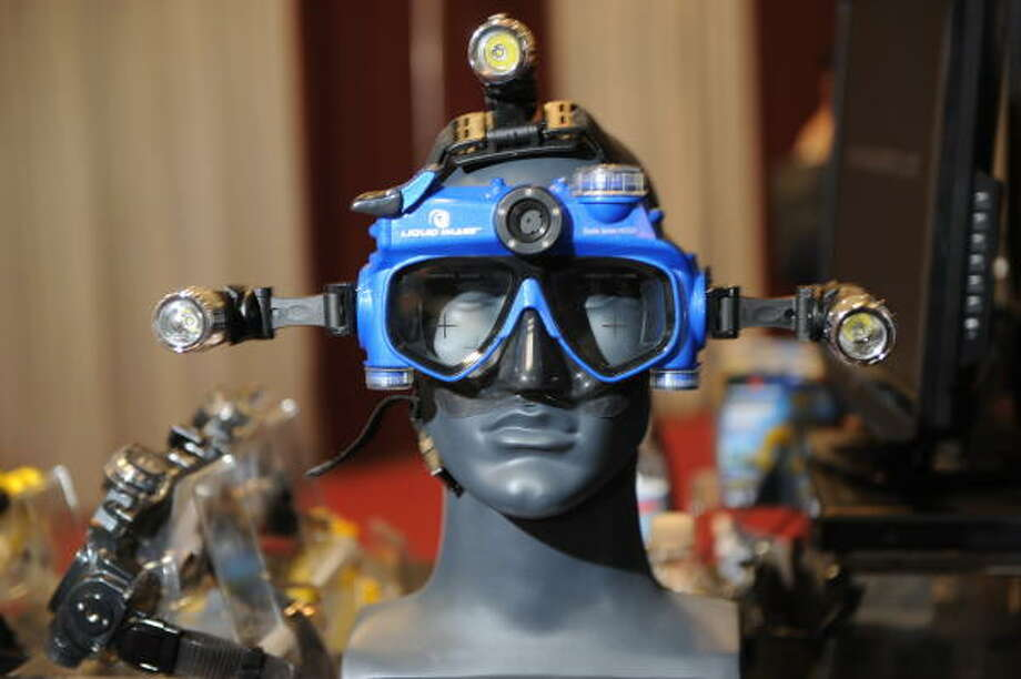 The Liquid Image underwater digital camera/video mask with lights is displayed at the 2009 Consumer Electronics Show in Las Vegas on Jan. 8.  The mask can take HD video and still photos and supporters up to a 32GB SD card for memory.  This model (Scuba Series HD320) is waterproof to 115ft while the pro model is waterproof to 330ft. Photo: ROBYN BECK, AFP/Getty Images