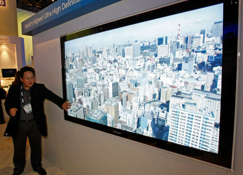 James Choi touches a concept ultra high definition LED 82-inch television at the Samsung booth at the 2009 International Consumer Electronics Show at the Las Vegas Convention Center Jan. 8. Photo: Ethan Miller, Getty Images