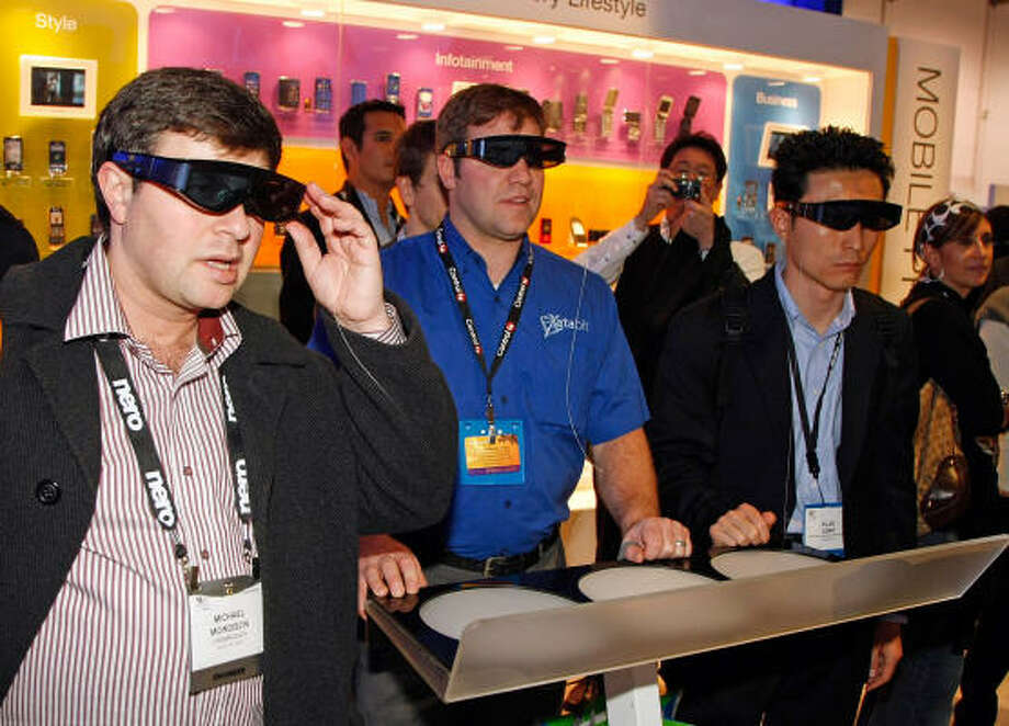 People use 3D glasses to watch a 3D Samsung television running a 3D Blu-ray disc at the 2009 International Consumer Electronics Show at the Las Vegas Convention Center Jan. 8. Photo: Ethan Miller, Getty Images