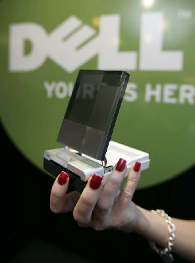 Dell shows off their Wasabi, a new small printer during a Dell news conference at the International Consumer Electronics Show in Las Vegas Jan. 9. Photo: Paul Sakuma, AP