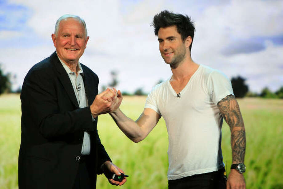 Adam Levine, the lead singer of Maroon 5, joins Intel Corp. Chairman Craig Barrett as Barrett gives his keynote address at the Venetian during the 2009 International Consumer Electronics Show Jan. 9 in Las Vegas. Photo: David McNew, Getty Images