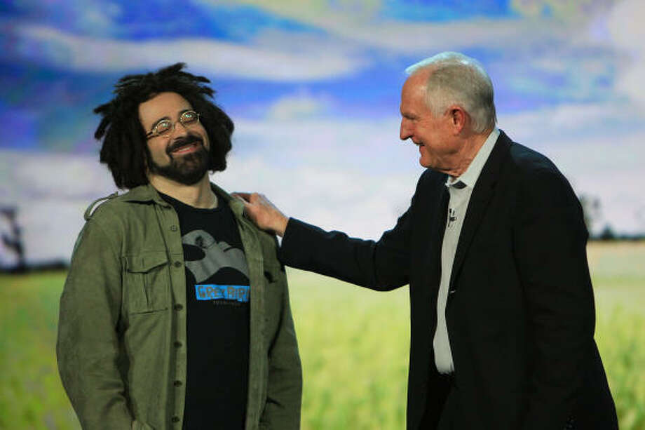 Adam Duritz, the lead singer of the Counting Crows, joins Intel Corp. Chairman Craig Barrett as Barrett gives his keynote address at the Venetian during the 2009 International Consumer Electronics Show Jan. 9 in Las Vegas. Photo: David McNew, Getty Images
