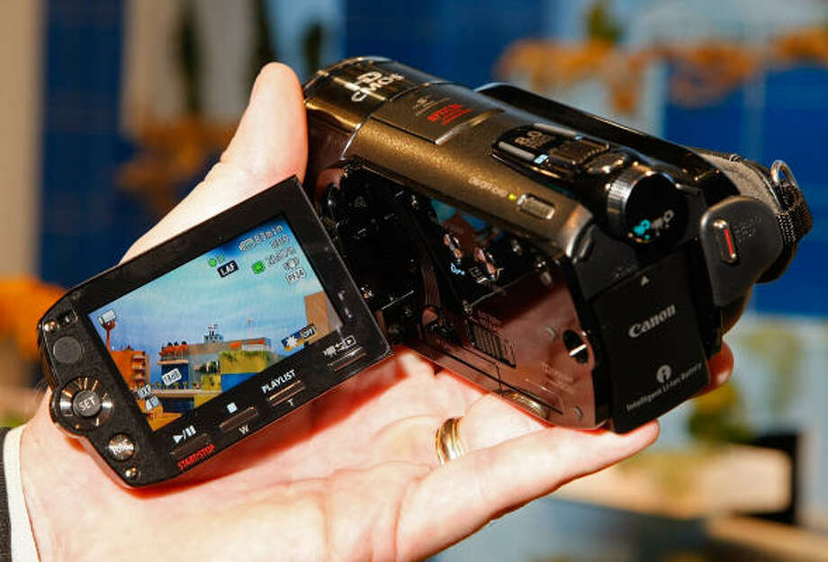 Canon's Vixia HF S10 high definition camcorder is displayed at the 2009 International Consumer Electronics Show at the Las Vegas Convention Center Jan. 9. The device can record up to 12 hours of high definition video on a 32 GB internal flash drive and features a 10x HD video lens and a built-in 8 megapixel digital camera. Photo: Ethan Miller, Getty Images