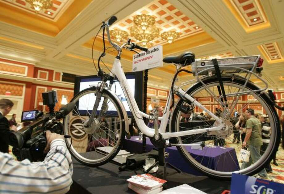 A battery powered Schwinn bike is shown at the International Consumer Electronics Show in Las Vegas, Friday, Jan. 9. Schwinn says it is one of the fastest recharging batteries for a bike. Photo: Paul Sakuma, AP