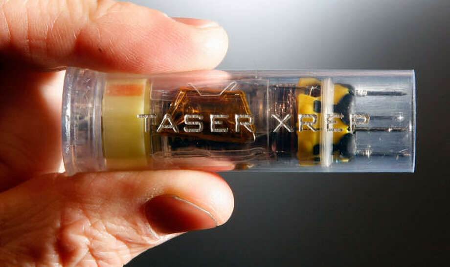 A Taser round in a shotgun shell is shown at the 2009 International Consumer Electronics Show at the Las Vegas Convention Center Jan. 9. Photo: Ethan Miller, Getty Images