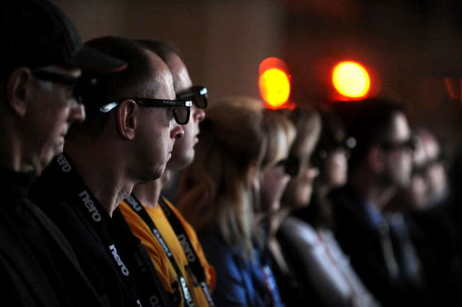 People wear Real D Cinema 3D glasses during a 3D video presentation during the keynote address by Sony CEO Howard Stringer at the 2009 Consumer Electronics Show on Jan. 8. Photo: ROBYN BECK, AFP/Getty Images