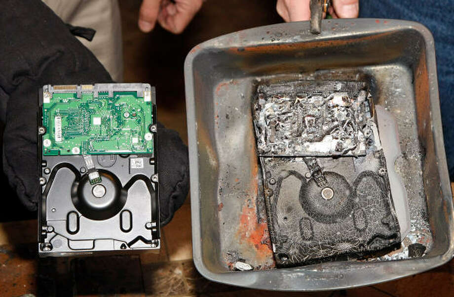 A hard drive that was encased in an ioSafe, Inc. Solo USB external hard drive and one that was not are shown at the 2009 International Consumer Electronics Show. The company offers a disaster recovery warranty with their products. Photo: Ethan Miller, Getty Images