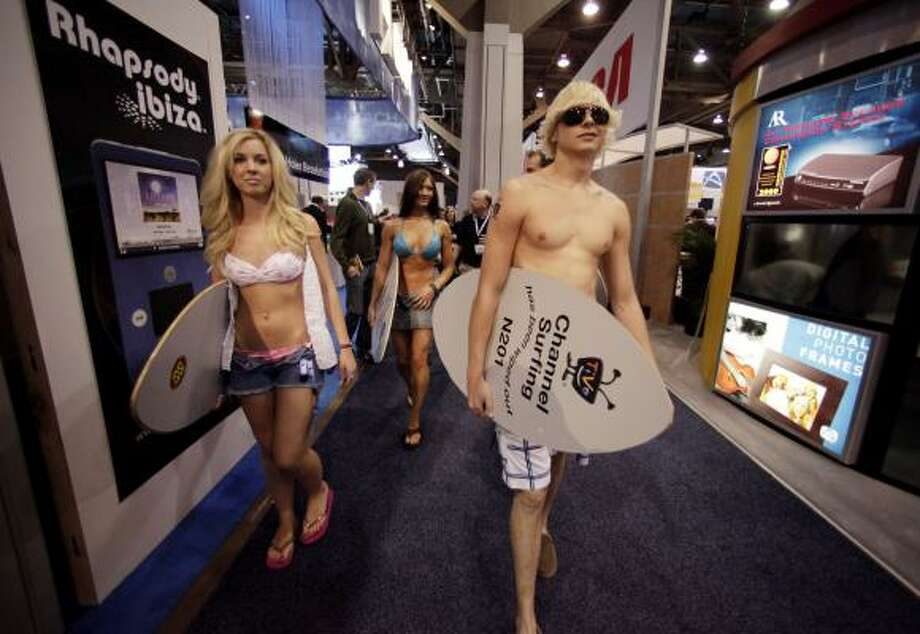 Models promoting TiVo walk around the show floor at the International Consumer Electronics Show in Las Vegas, Thursday, Jan. 8. Photo: Jae C. Hong, AP