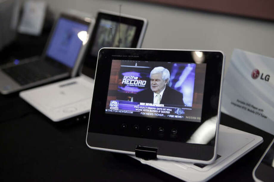 Portable DVD players with integrated ATSC Mobile DTV tuners are shown at the International Consumer Electronics Show in Las Vegas Jan. 8. Photo: Jae C. Hong, AP