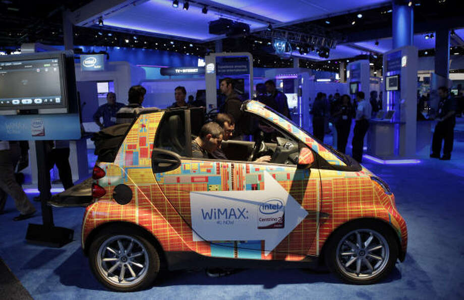 Show attendees check out Intel's WiMAX smart car at the International Consumer Electronics Show in Las Vegas on Jan. 8. Photo: Jae C. Hong, AP