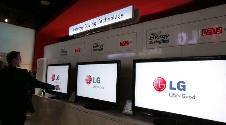 Counters display the amount of energy saved with three LG television monitors at the LG booth at the International Consumer Electronics Show in Las Vegas on Jan. 8. Photo: Paul Sakuma, AP