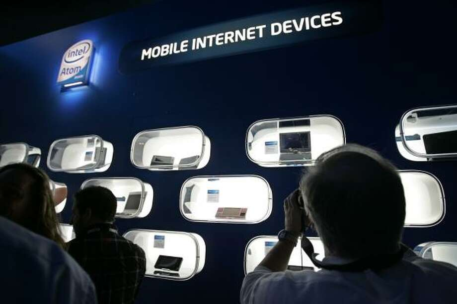 Several computing devices that use the Intel Atom chip are on display in the Intel booth at the International Consumer Electronics Show in Las Vegas on Jan. 8. Photo: Paul Sakuma, AP