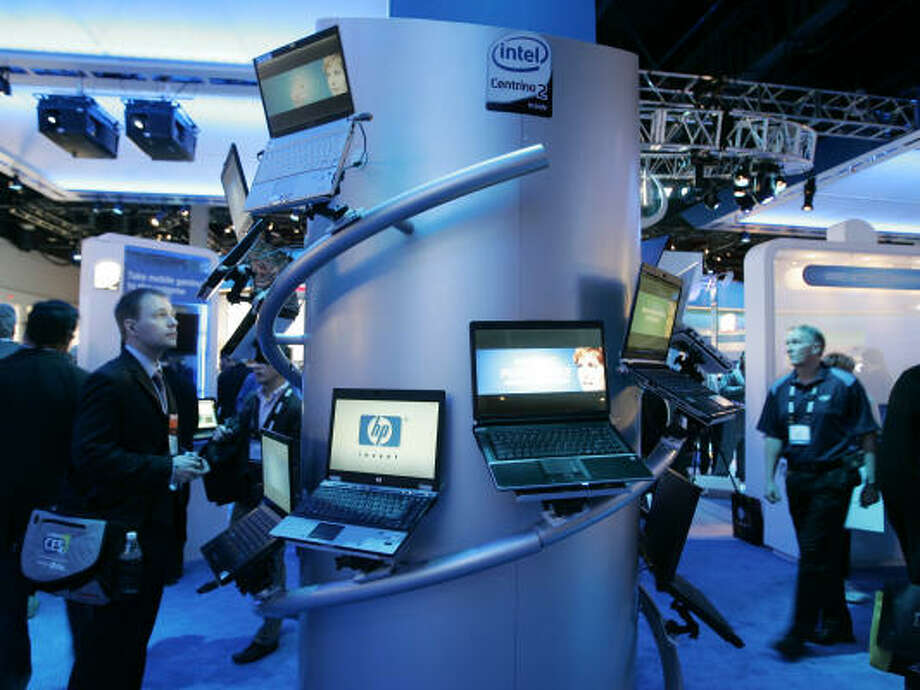 Several laptops that use the Intel Centrino 2 chip are shown in the Intel booth at the International Consumer Electronics Show in Las Vegas Jan. 8. Photo: Paul Sakuma, AP