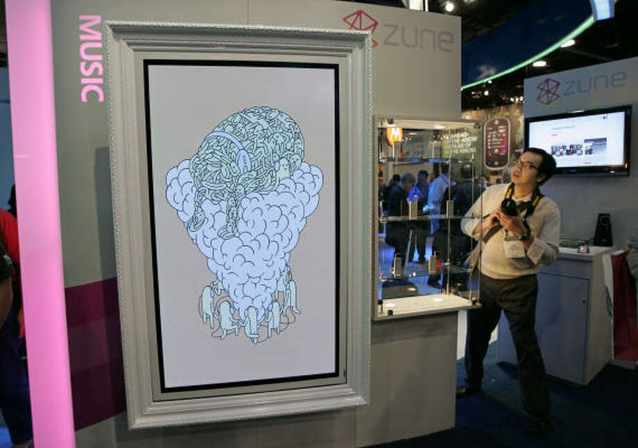 Microsoft Zune music products on display next to artwork in the Microsoft booth at the International Consumer Electronics Show in Las Vegas Jan. 8. Photo: Paul Sakuma, AP