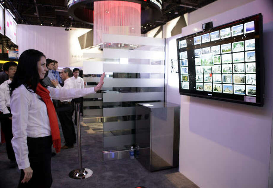 A booth hostess demonstrates Spatial Motion Interface at the Toshiba booth at the International Consumer Electronics Show in Las Vegas on Jan. 8. Photo: Jae C. Hong, AP