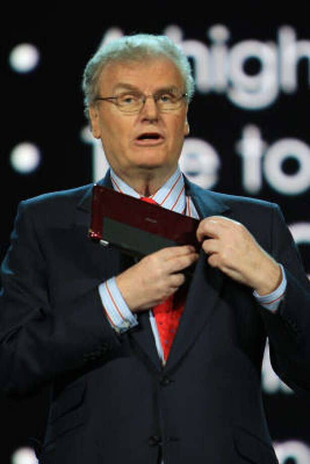 Sony Corp. Chairman and CEO Sir Howard Stringer puts a Sony Vaio computer into his pocket during his keynote address during the 2009 International Consumer Electronics Show in Las Vegas. Photo: David McNew, Getty Images