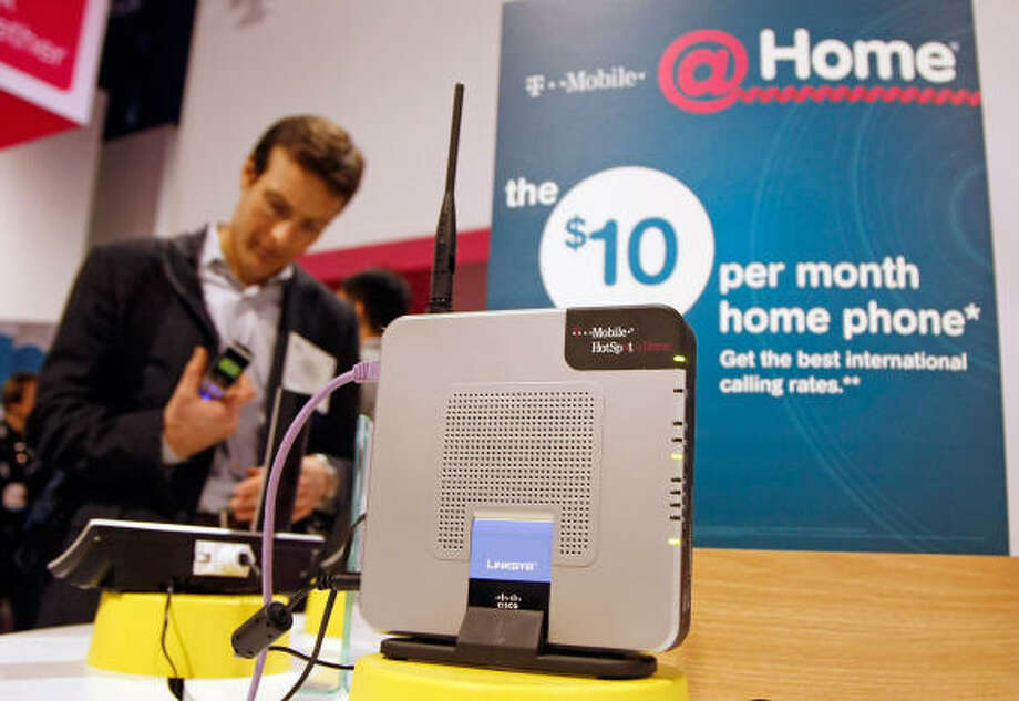 A Linksys router is displayed at the T-Mobile booth. T-Mobile is offering a $10.00 per month home phone plan that uses the router with your high speed Internet and unlimited phone minutes on up to two different phone numbers. Photo: Ethan Miller, Getty Images