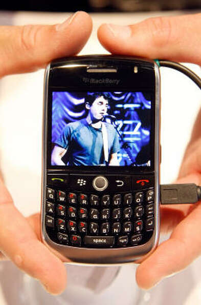 A Blackberry Curve 8900 is displayed as it plays a music video at the 2009 International Consumer El