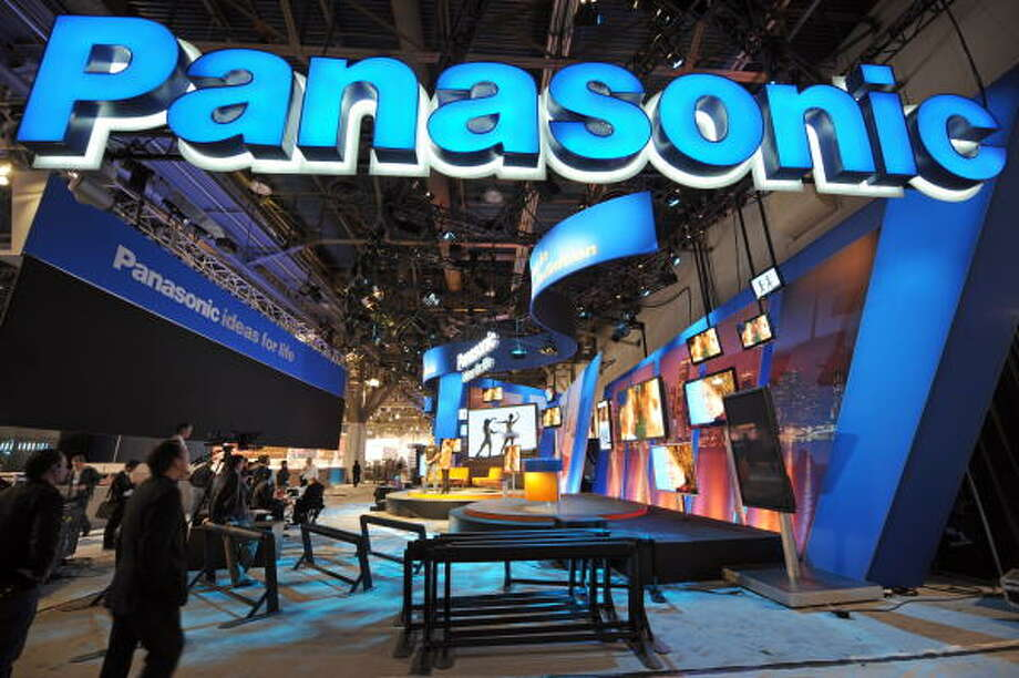 People walk by the Panasonic display during set up. Photo: ROBYN BECK, AFP/Getty Images