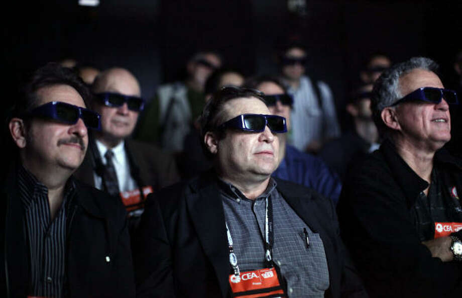 Members of the media wear 3D glasses as they watch movie clips at the Panasonic 3D full HD plasma theater. Photo: Jae C. Hong, AP