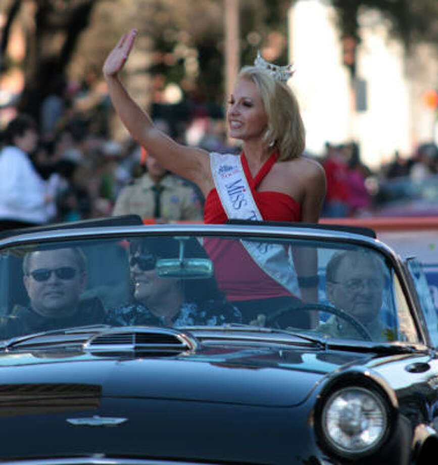 Rebecca Robinson, Miss Texas 2008, waves to the crowd during the Comerica Bank New Years Parade on Jauary 1, 2009. Photo: Rex C. Curry