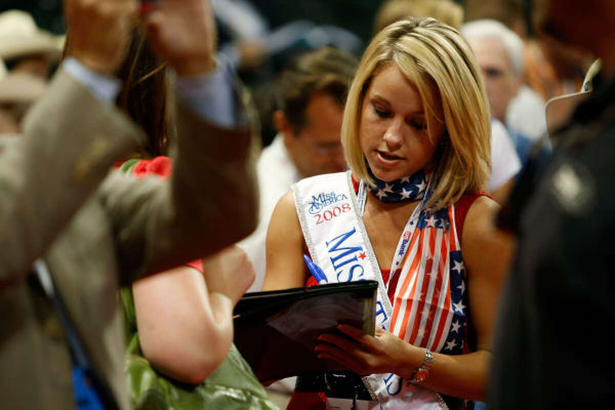 ST. PAUL, MN - SEPTEMBER 01: Miss Texas Rebecca Robinson signs an autograph on day one of the Republican National Convention (RNC) at the Xcel Energy Center on September 1, 2008 in St. Paul, Minnesota. The GOP will nominate U.S. Sen. John McCain (R-AZ) as the Republican choice for U.S. President on the last day of the convention.