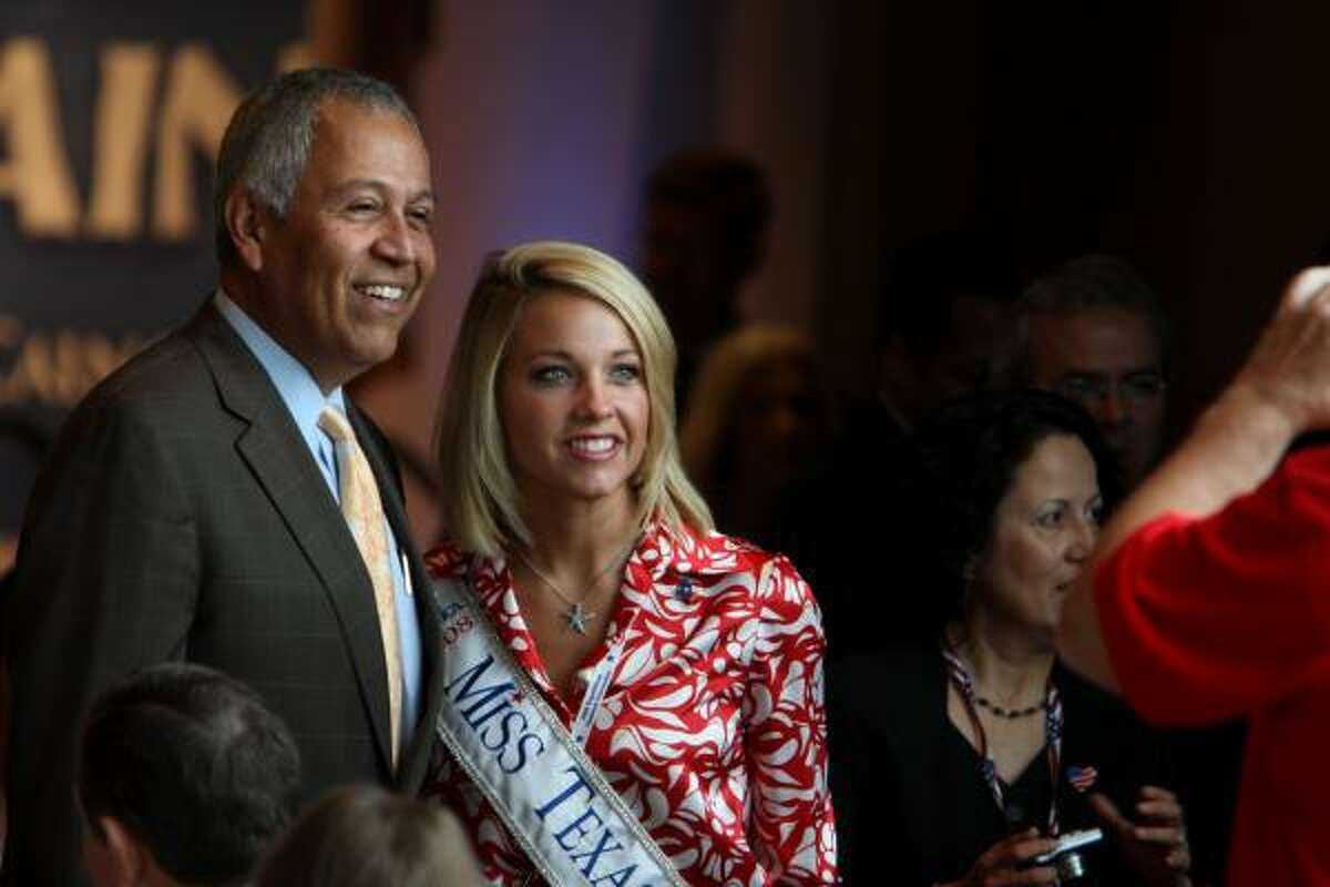 (09/02/08) -- Henry Bonilla, left, poses for a photo with Miss Texas Rebecca Robinson at the Texas delegation breakfast at the Crowne Plaza hotel in St. Paul, MN, Tuesday September 2, 2008.