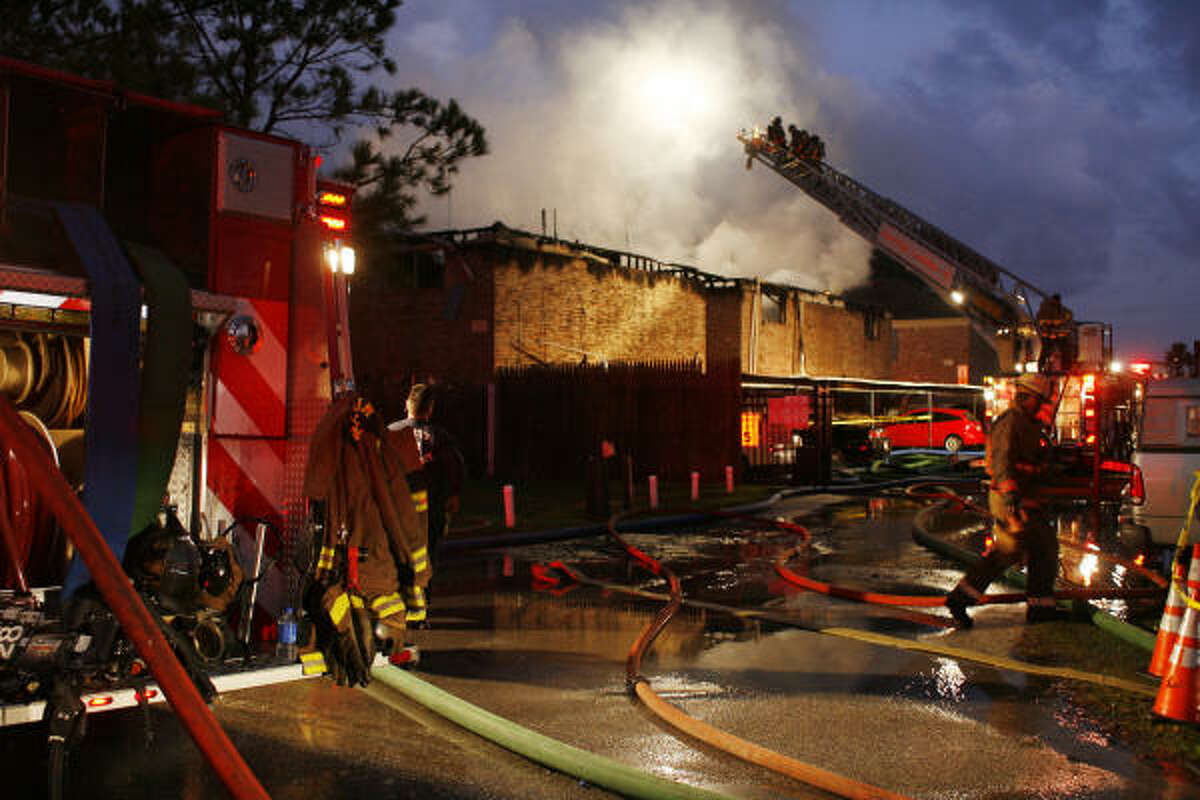 A three-alarm blaze damaged or destroyed up to 20 units at Enchanted Fountains Apartments, 6909 Renwick at Edgemore, early Friday, Jan. 9, 2009, before firefighters extinguished it, almost two hours after it was reported.