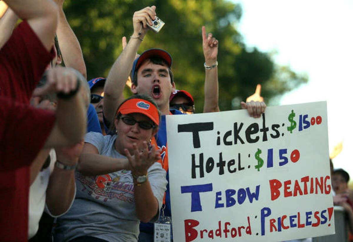 Fans of the Florida Gators hold up a sign in support of the Gators against the Oklahoma Sooners before the start of the FedEx BCS National Championship game.