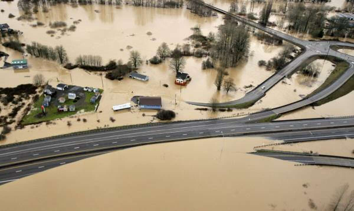 Interstate 5, at bottom, is partially covered by muddy flood water from the Chehalis River on Jan. 8, 2009, in Chehalis, Wash.