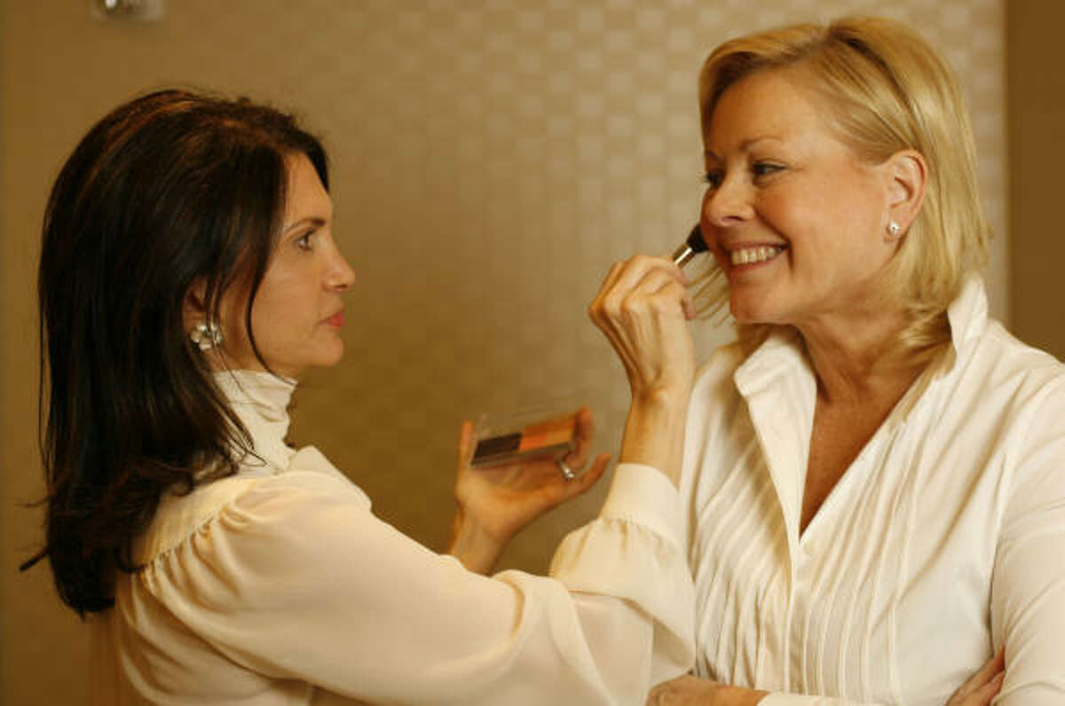 Makeup guru Trish McEvoy applies a bronzer to give her model a warm glow.