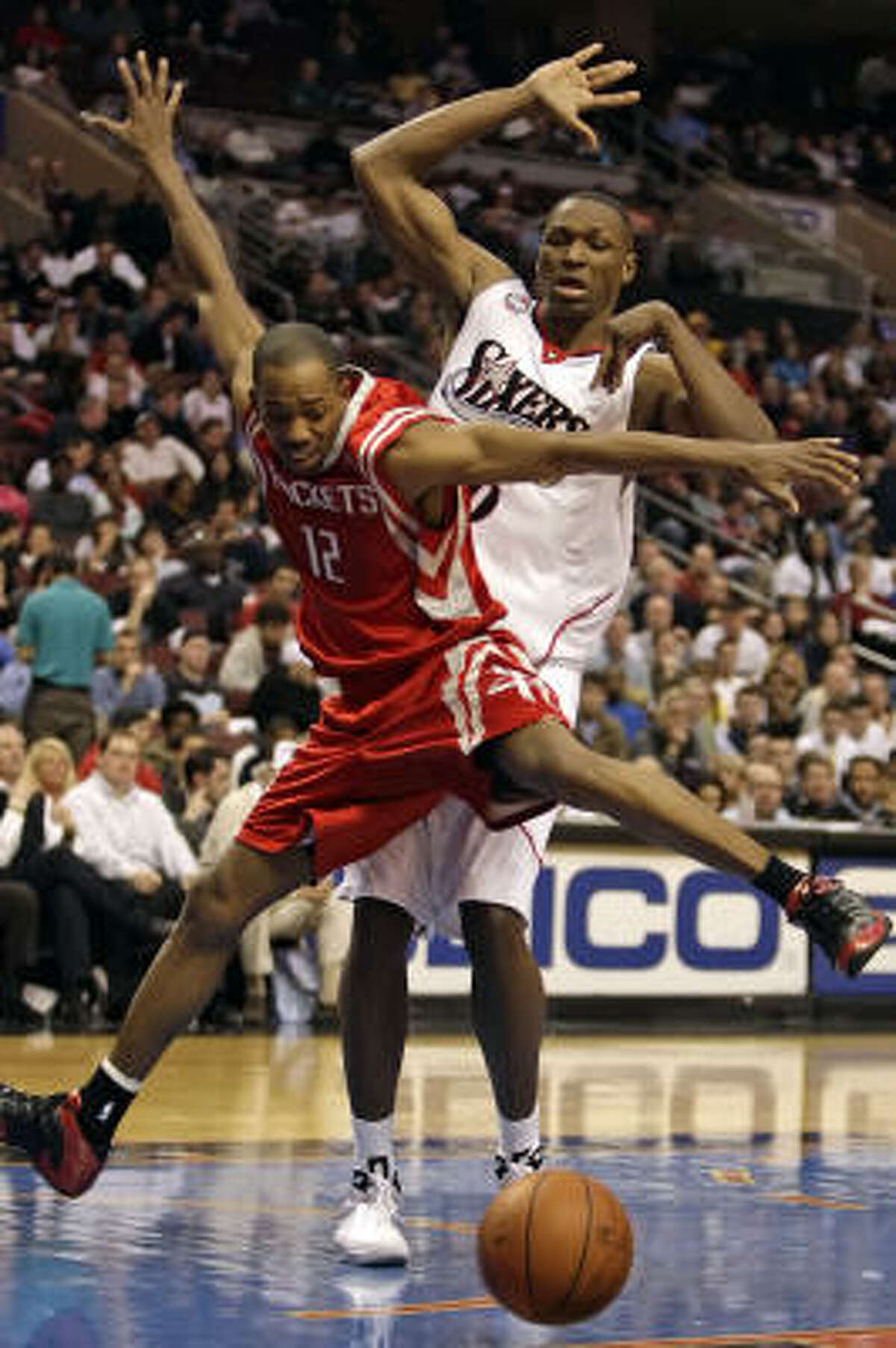 Rafer Alston, left, has his shot rejected courtesy of Philadelphia's Theo Ratliff in the fourth quarter.