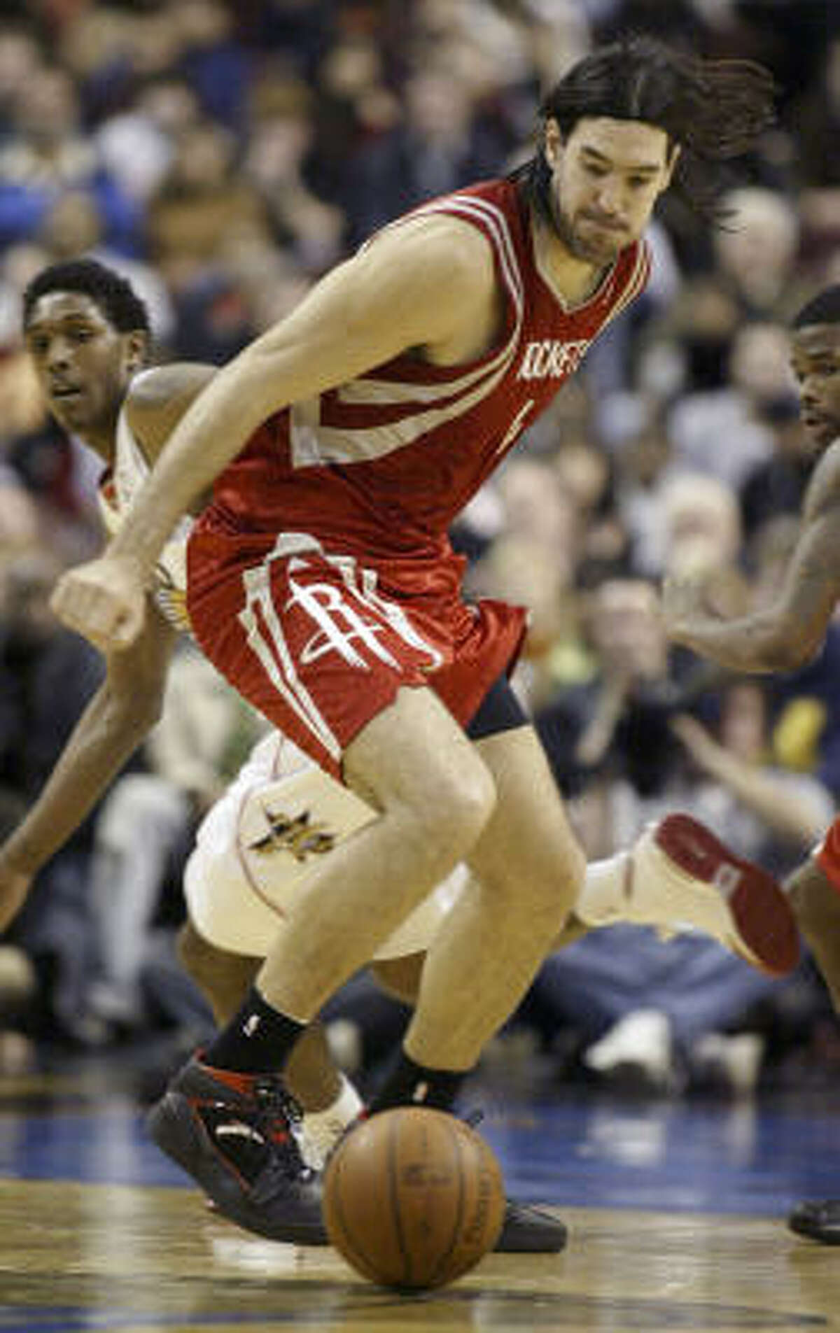 Luis Scola attempts to track down a loose ball in the second half.