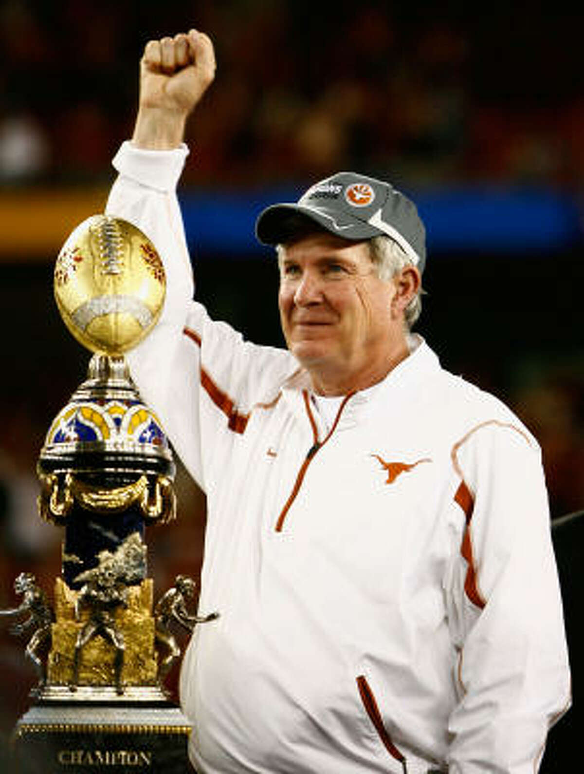Head coach Mack Brown celebrates after defeating the Ohio State Buckeyes.