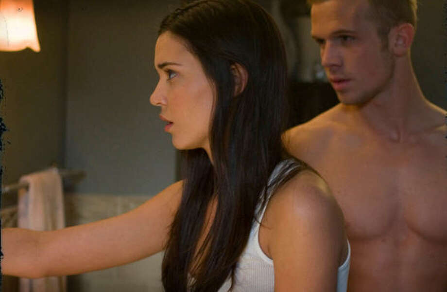 Odette Yustman, left, and Cam Gigandet star in The Unborn. Photo: Rogue Pictures