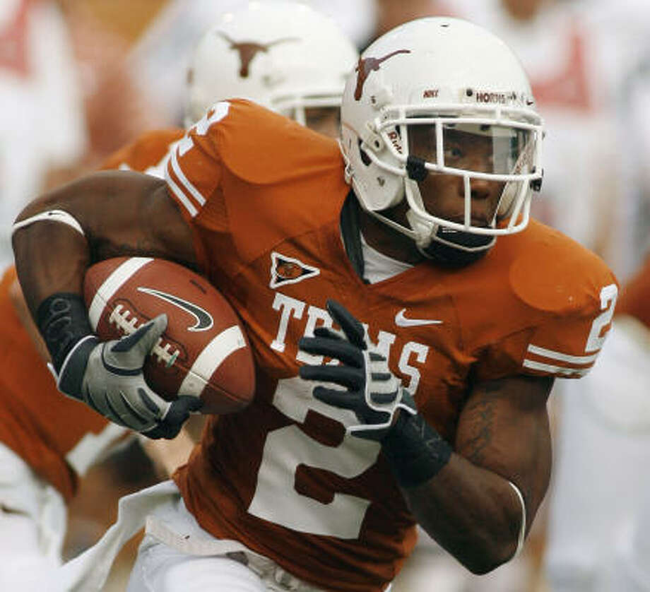 When: August 30. Score: Texas beat Florida Atlantic, 52-10. Hero: Texas running back Vondrell McGee looks for daylight around his right end after taking a handoff from quarterback Colt McCoy, background, during first quarter. McGee finished with 63 yards on 12 carries. McCoy threw for 222 yards and three touchdowns. Record: 1-0. Photo: Harry Cabluck, AP
