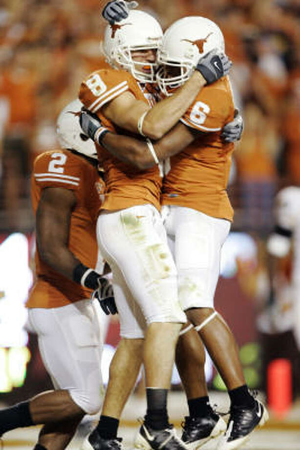 When: October 18. Score: Texas beat Missouri, 56-31. Hero: Wide receiver Jordan Shipley (8) celebrates his touchdown catch with Quan Cosby (6) in the second quarter. Shipley finished with eight catches, 89 yards, an 11.1 average per carry and a touchdown. Record: 7-0. Photo: Brian Bahr, Getty Images