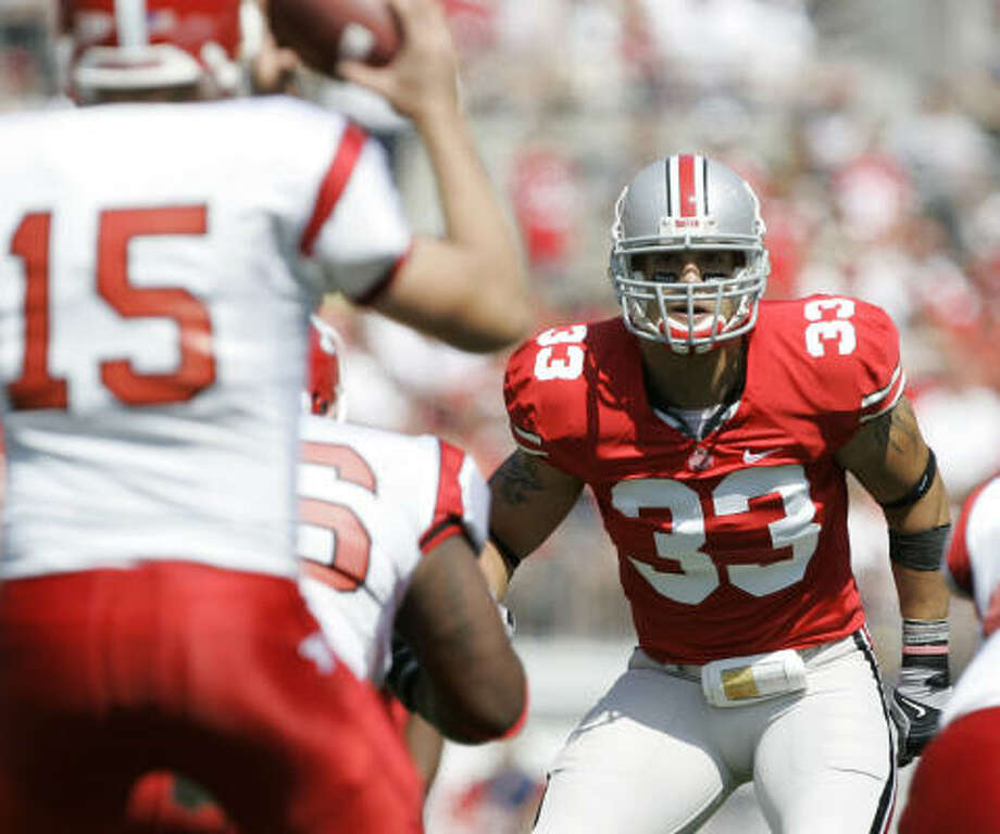 When: Aug. 30. Score: Ohio State 43, Youngstown State 0. Hero: Running back Chris Wells rushed for 111 yards but was injured during the game. Linebacker James Laurinaitis (above) and the Ohio State defense had a shutout. Record: 1-0. Photo: Kiichiro Sato, AP