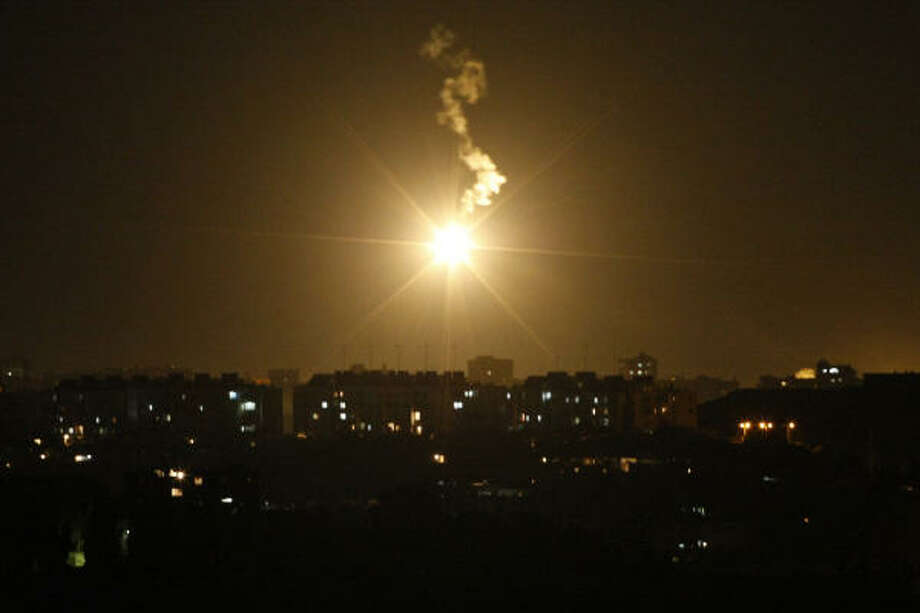 An illumination flare fired by Israeli forces is seen above the northern Gaza Strip from the Israeli side of the border with Gaza, Saturday, Jan. 3. Photo: Bernat Armangue, Associated Press