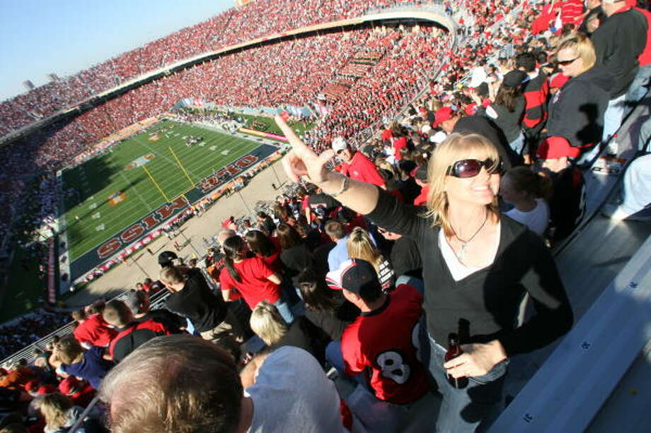 COLLEGE FOOTBALLThe Cotton Bowl hosted what's likely its last college postseason game as Mississippi beat Texas Tech 34-28 in the stadium's namesake game. The crowd of more than 80,000 in Dallas included Lynn Dabie (with hand up). Photo: Billy Smith II, Chronicle