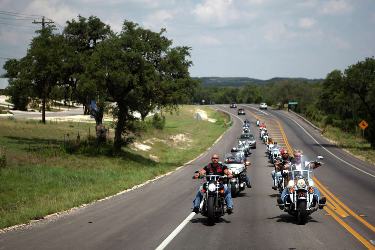 Members of the San ANtonio chapter of the Fire & Iron Firefighter's Motorcycle Club head out on Texas 46 for a ride through the Hill Country. ANDREW BUCKLEY / EXPRESS-NEWS