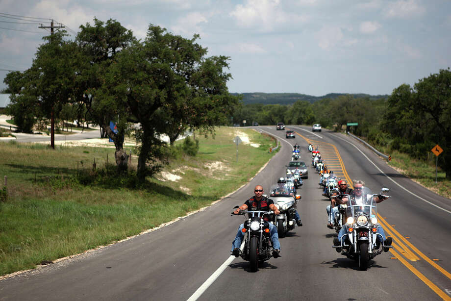 Members of the San ANtonio chapter of the Fire & Iron Firefighter's Motorcycle Club head out on Texas 46 for a ride through the Hill Country. ANDREW BUCKLEY / EXPRESS-NEWS / Copyright: Andrew Buckley