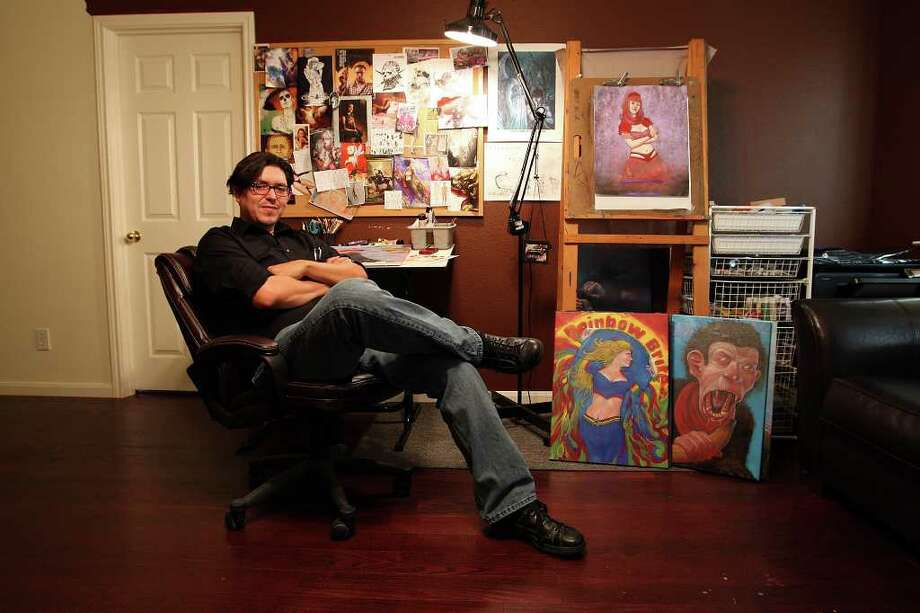 "Local artist Alfredo ""Freddy"" Lopez, Jr., sits in his second floor studio at his home on the far northwest part of San Antonio, Wednesday, July 27, 2011. Lopez genre is geek-related mash-up art that includes pairing actor Danny Trejo as Han Solo with Chewbacca from ""Star Wars"". Photo: JERRY LARA, JERRY LARA/glara@express-news.net / SAN ANTONIO EXPRESS-NEWS"