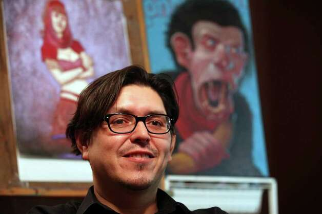 "Local artist Alfredo ""Freddy"" Lopez, Jr., sits in his second floor studio at his home on the far northwest part of San Antonio, Wednesday, July 27, 2011. Photo: JERRY LARA, JERRY LARA/glara@express-news.net / SAN ANTONIO EXPRESS-NEWS"