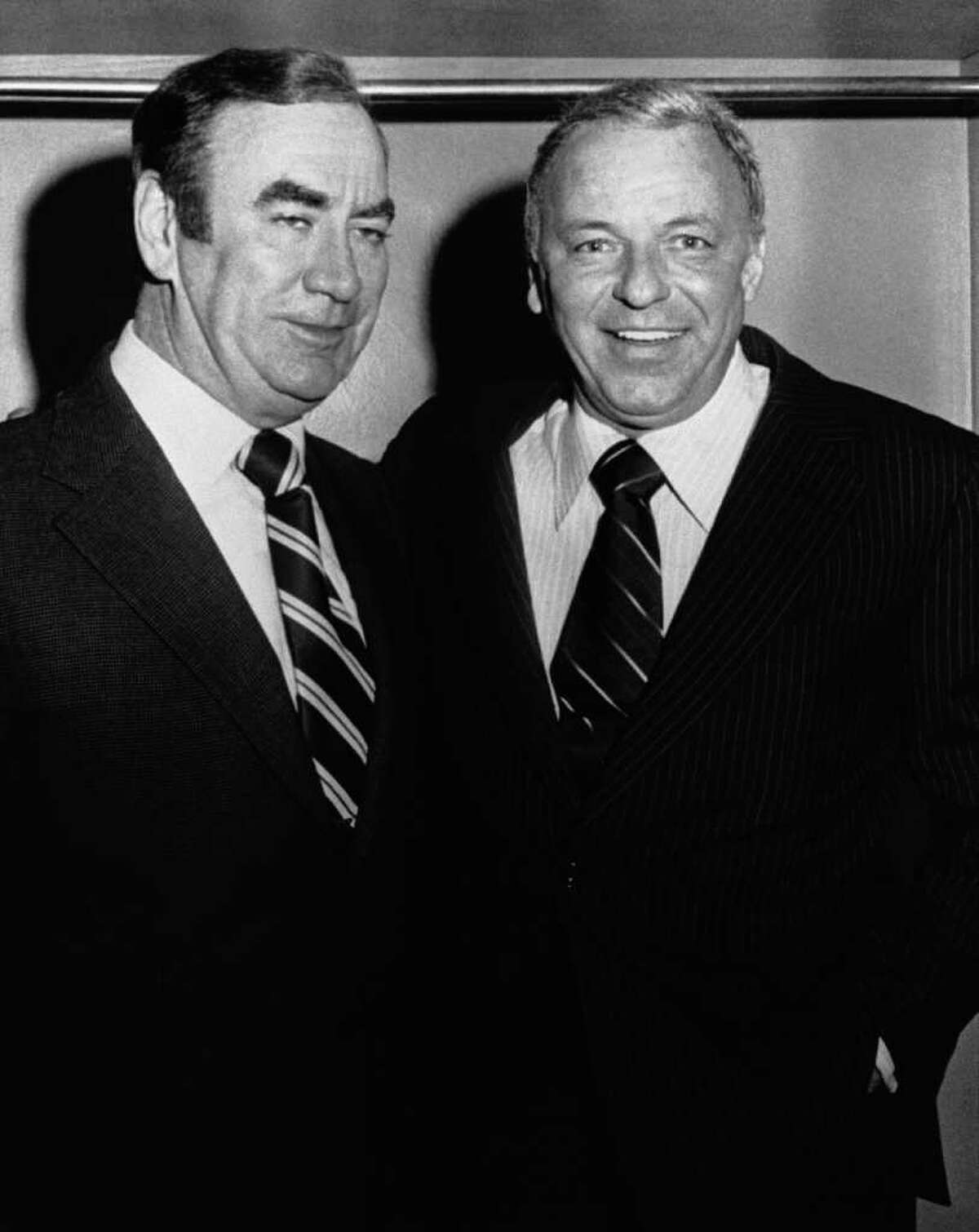 FILE - In this September 1975 file photo, New York Gov. Hugh Carey, left, visits singer Frank Sinatra backstage at the Uris Theater in New York, after Sinatra's performance. Carey, who led the rescue effort that brought New York City back from the brink of bankruptcy during its 1975 fiscal crisis, died Sunday, Aug. 7, 2011. He was 92.