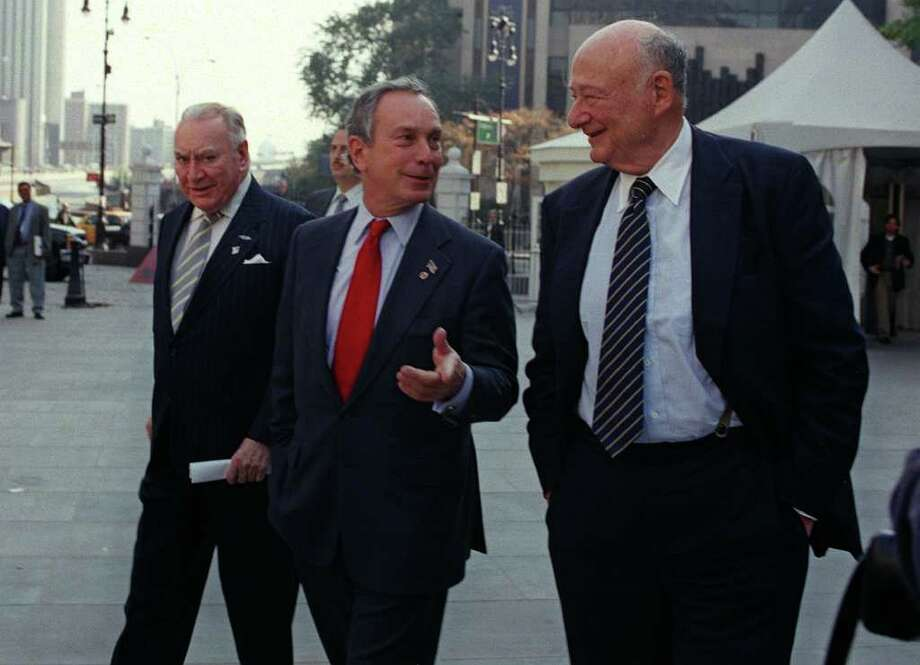 Former New York Gov. Hugh Carey, left, and former New York City Mayor Ed Koch walk with Republican mayoral candidate Michael Bloomberg Thursday, Nov. 1, 2001, to a press conference outside New York's City Hall. The two former elected officials crossed party lines to announce their support of Bloomberg. Photo: MARTY LEDERHANDLER, AP / AP