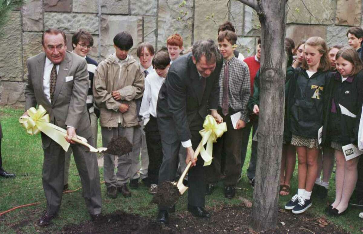 Times Union photo by STEVE JACOBS ,4/24/96, Albany,NY-- NYS Governor Pataki,right, and former NYS Governor Hugh Carey,left, shovel the ground around a tree in the Executive Mansion yard after an Arbor Day tree dedication to Hugh Carey, Wednesday. ( for story) 1 of 2 photos 04/25/96