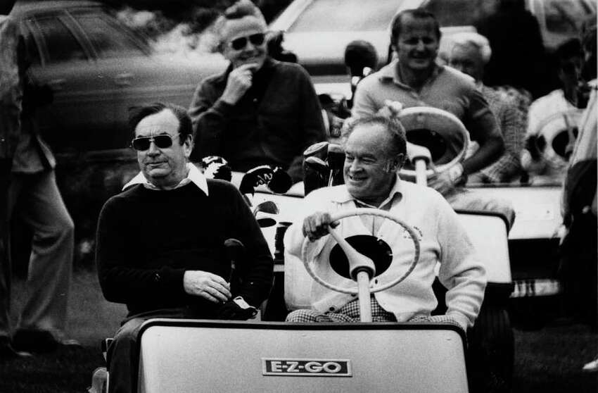 TIMES UNION ARCHIVE PHOTO : Bob Hope , left, rides in golf cart with New York Gov. Hugh Carey during a round of golf at the Albany Country Club in Guilderland on June 23, 1977.